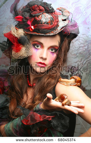 stock-photo-portrait-on-young-stylish-woman-with-creative-visage-and-with-snails-68045374