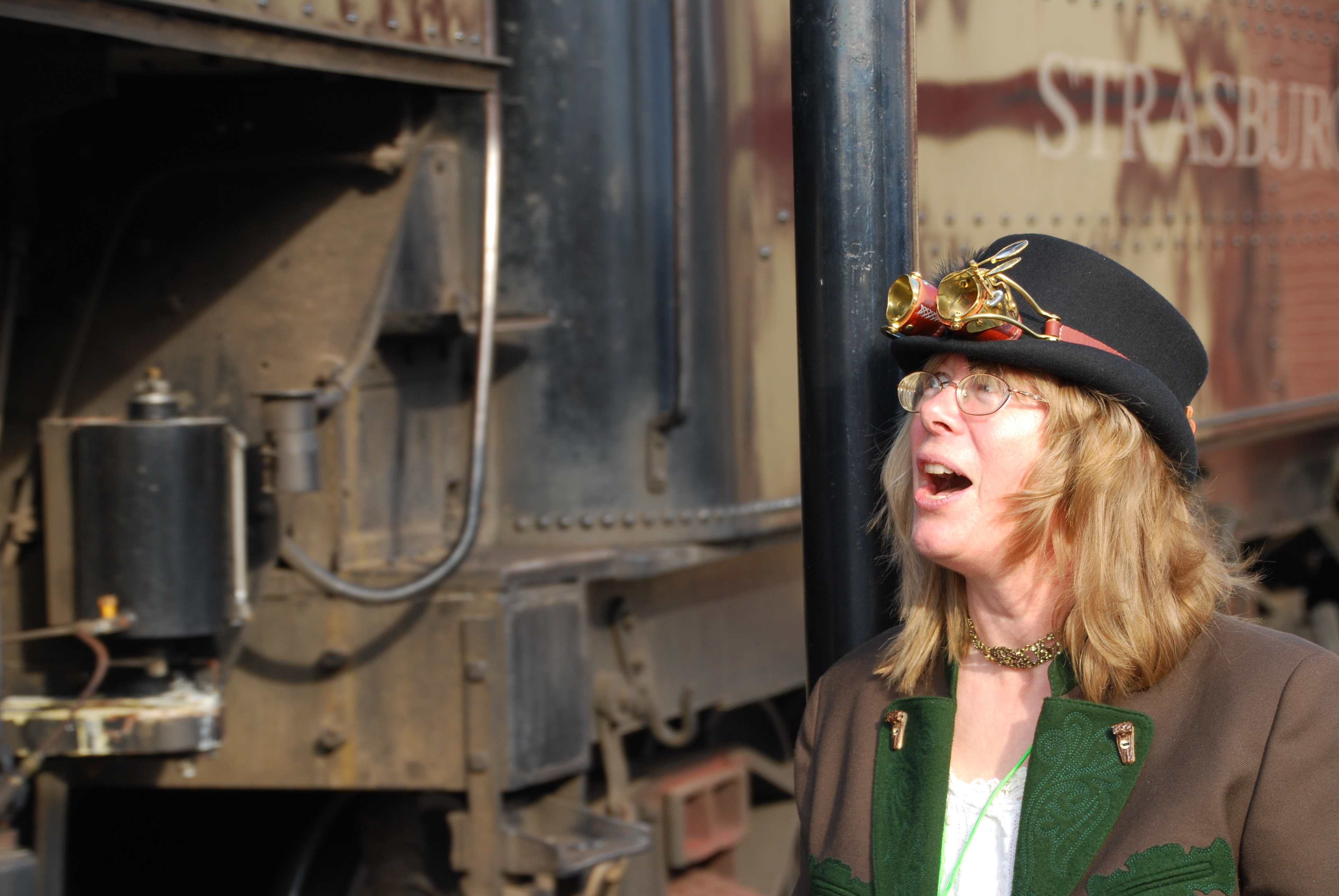 Shelley Adina watches the #90 locomotive pass at Steampunk UnLimited, Strasburg, PA