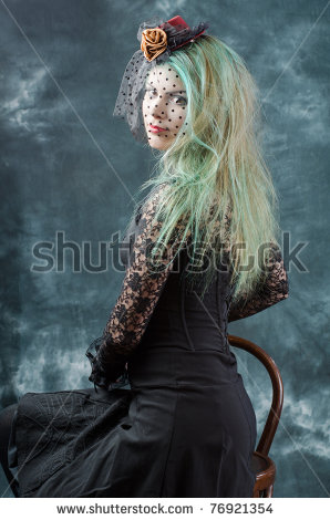 stock-photo-young-seductive-girl-dressed-in-gothic-style-poses-at-studio-s-dark-background-76921354
